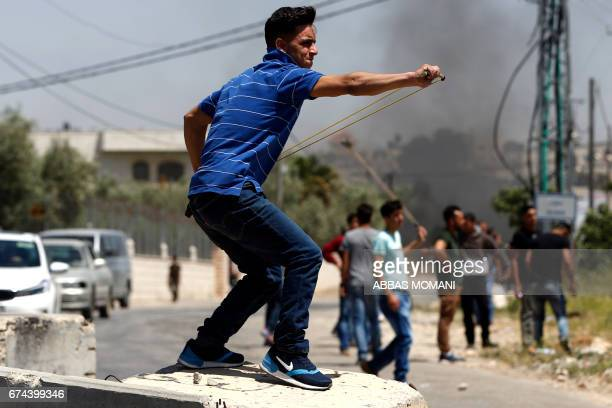 Palestinian protesters clash with Israeli soldiers during a demonstration in support of Palestinian prisoners on hunger strike in Israeli jails in...