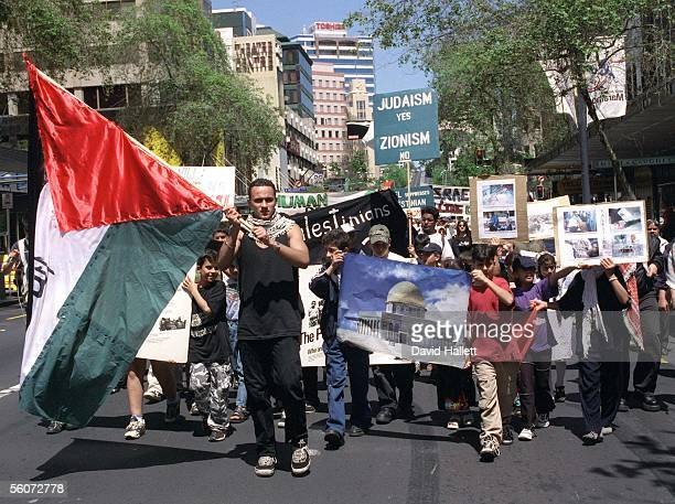 Palestinian protesters march down Queen St in protest against the lack of human rights against Palestinians in Israel