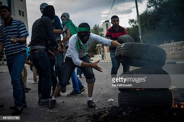 Palestinian protesters pile tires to burn during clashes with IDF and Israeli Border Police on October 8 2015 in BeitEl WestBank As Tension rises...