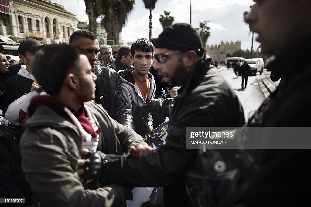 Palestinian protesters scuffle with Israeli policemen during a demonstration against Jerusalem's third annual marathon on March 1, 2013. About 20,000 runners took part in Jerusalem's third annual marathon, with 1,000 police deployed to provide security along the route, police said. The Palestine Liberation Organisation had called for a boycott of the marathon, part of which went through annexed east Jerusalem.