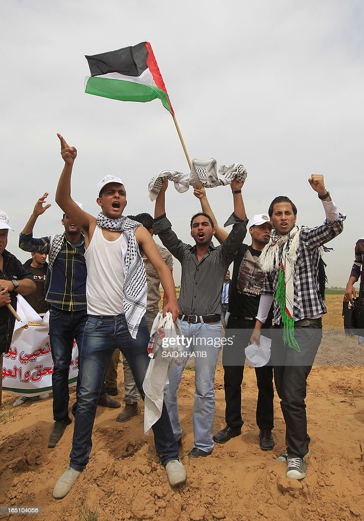 Palestinian protesters shout slogans during a rally marking Land Day near the southern Gaza Strip's border with Israel, east of Rafah, on March 30, 2013. Land Day commemorates the death of six Arab Israeli protesters at the hands of Israeli troops during mass protests in 1976 against plans to confiscate land in Galilee. AFP PHOTO/ SAID KHATIB