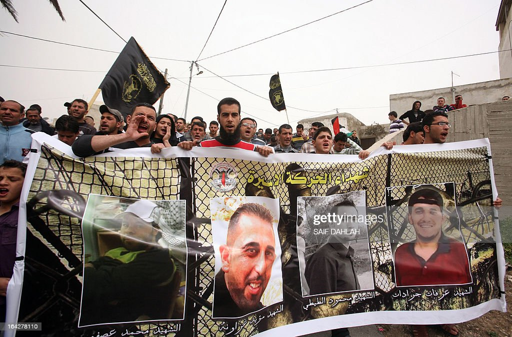 Palestinian protesters shout slogans in the northern West Bank village of Araba, near Jenin, on March 22, 2013 during a protest against the visit of US President Barack Obama to the Palestinian territories and to demanding the release Palestinian prisoners in Israeli jails.