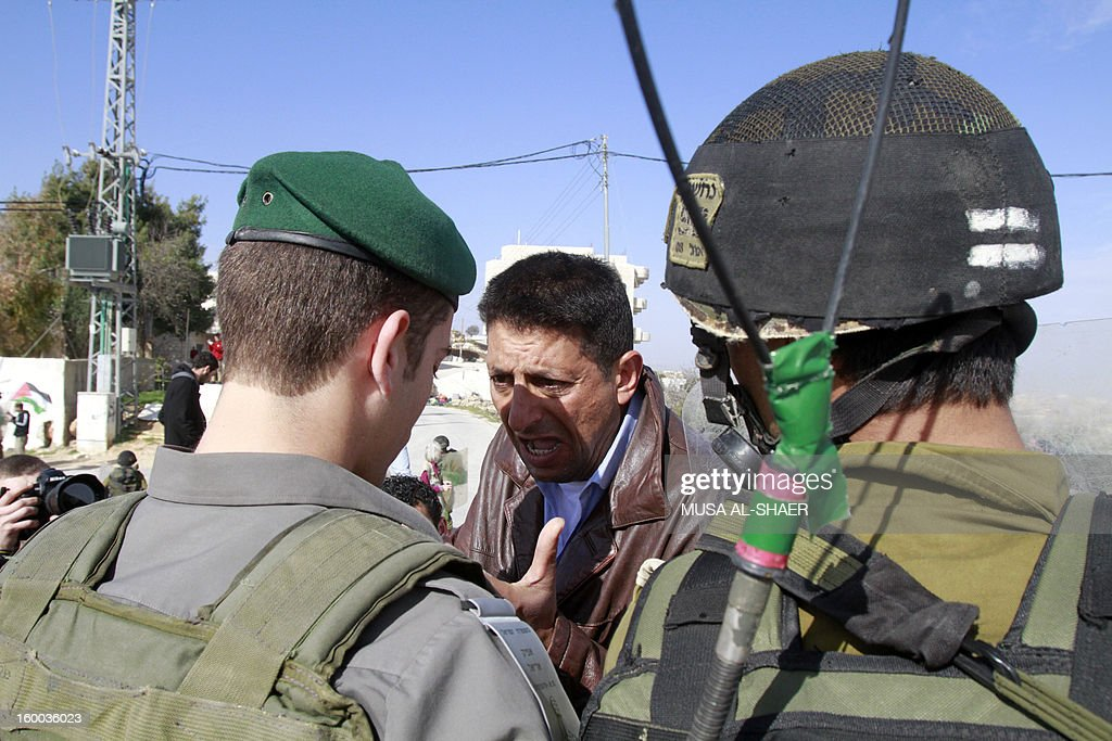 A Palestinian protestor argues with Israeli soldiers during a weekly demonstration against Israeli occupation in the West Bank village of Maasarah near Bethlehem on January 25, 2013. The Palestinian leadership wants new dialogue with Israeli political parties, particularly centrists who emerged strong in this week's election, an official said Thursday.