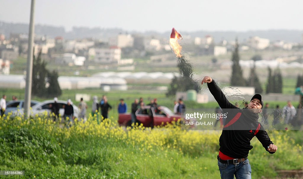 A Palestinian protestor hurls a petrol bomb at Israeli police during clashes at the entrance of the Jalama checkpoint, near the West Bank city of Jenin, on February 22, 2013. Palestinians demanding the release of hunger-striking prisoners clashed with Israelis in the West Bank and east Jerusalem, as three fasting inmates were taken to hospitals. AFP PHOTO/SAIF DAHLAH