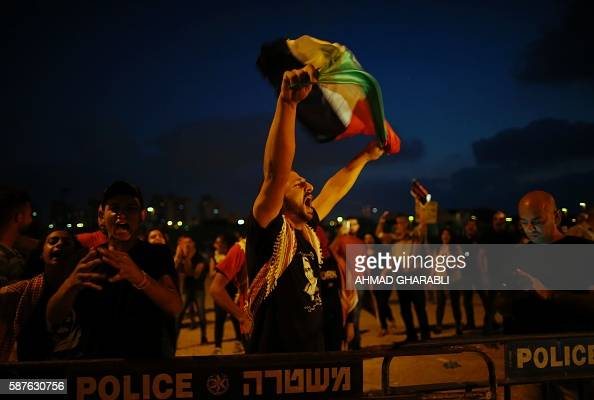 Palestinian protestor waves his national flag during a demonstration against administrative detention and in support of Palestinian prisoner Bilal...