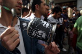 Palestinian protestors bang on pots covered in pictures of Palestinian prisoners Mahmoud alSarsak and Akram alRikhawi who are still refusing food a...