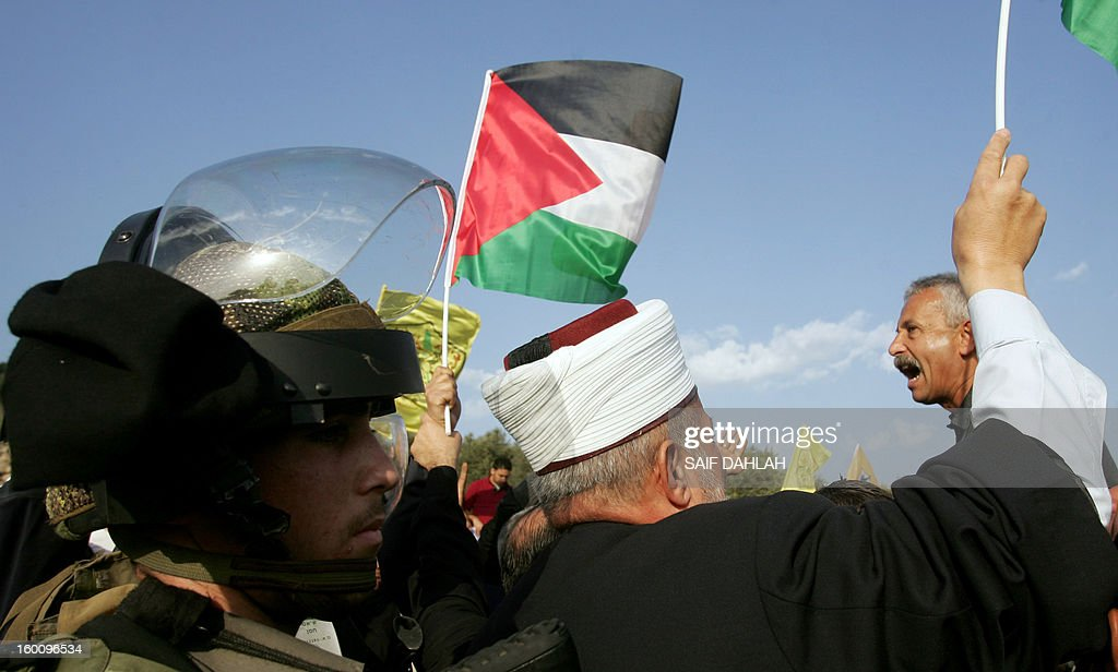 Palestinian protestors chant slogans during a protest in Anin village in the West Bank near Jenin city, on January 26, 2013. Protestors planned to erect a number of tents in solidarity with Palestinian prisoners in Israeli jails, a move they called 'Breaking the constraint'.
