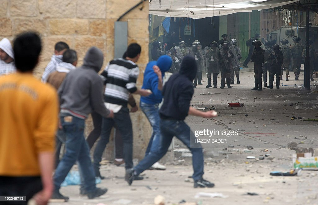 Palestinian protestors clash with Israeli border guard in al-Shuhada street in the West Bank town of Hebron on February 22, 2013 during a protest demanding the right of access for Palestinians to the street that can only be used by Israeli settlers.