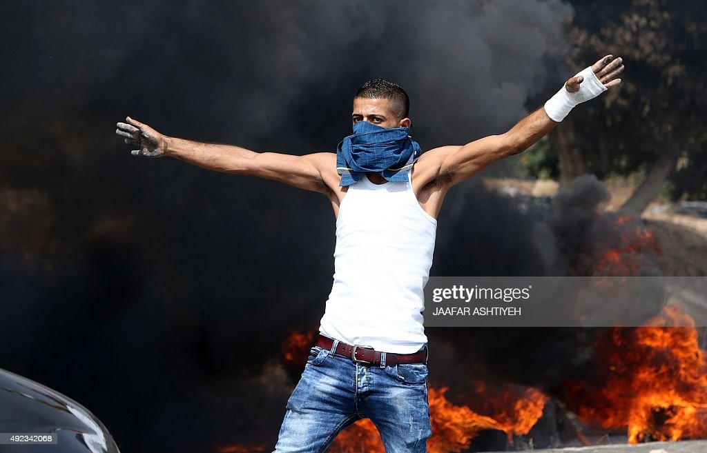 Palestinian protestors clash with Israeli security forces at the Hawara checkpoint south of the West Bank city of Nablus on October 12 2015 Three new...