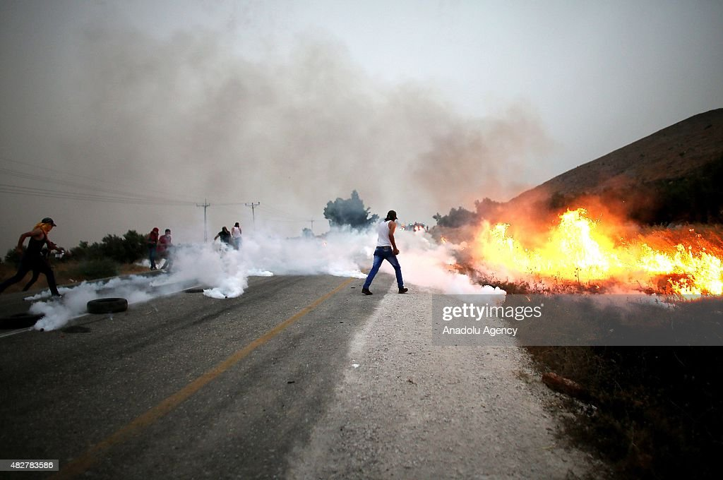 Palestinian protestors clash with Israeli security forces during a protest for Ali Dawabsheh Palestinian baby killed when Jewish residents of the...