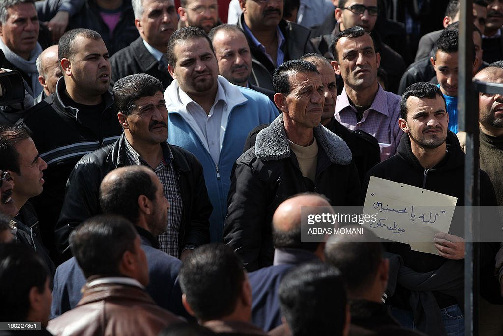 Palestinian protestors gather in front of prime minister Salam Fayyad's office in Ramallah on January 28, 2013 to demand his departure from government due to delayed salary payments for hunderds of government employees.