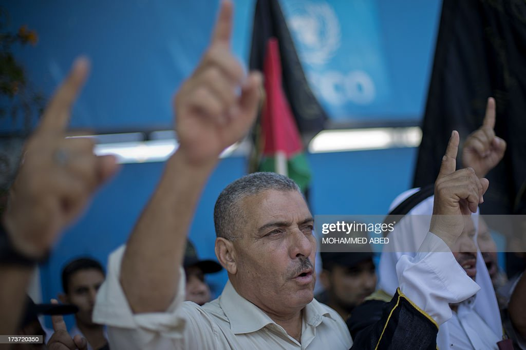 Palestinian protestors shout slogans next to the UNESCO headquarters in Gaza City during a demonstration against the Israeli government's plans to relocate Bedouins in the Negev desert, on July 17, 2013. Thousands of Bedouin marched demonstrated to protest a government plan to settle tens of thousands of their desert-dwelling people in permanent townships, media reported. There are around 260,000 Bedouin in Israel, mostly living in and around the Negev in the arid south.