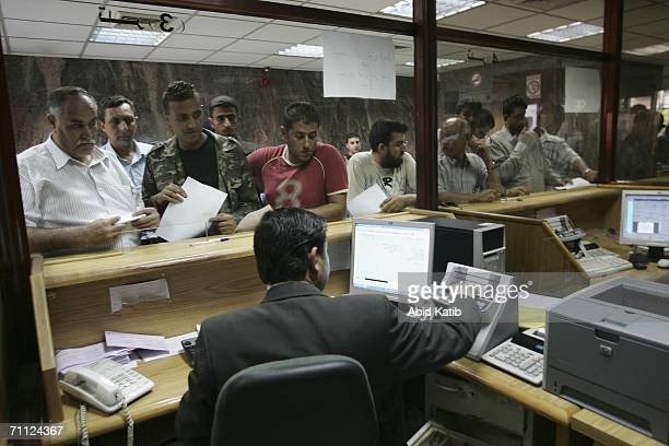 Palestinian public workers wait to receive their salaries at the Palestine Bank June 5 2006 in Gaza City Gaza Strip Some Palestinian public workers...