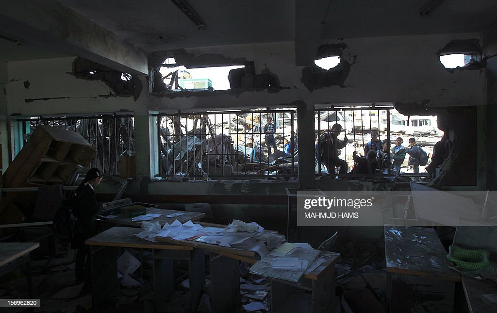 Palestinian pupils stand outside a destroyed class room on November 26, 2012 in Gaza city. The school was damaged some days ago, before a truce between Hamas and Israel ended eight days of cross border attacks in which 166 Palestinians and six Israelis died.