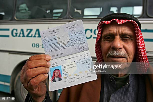 Palestinian refugee Abed Alqader Qwaider shows his temporary Jordanian passport as he comes to visit his relatives November 15 2005 at the border...