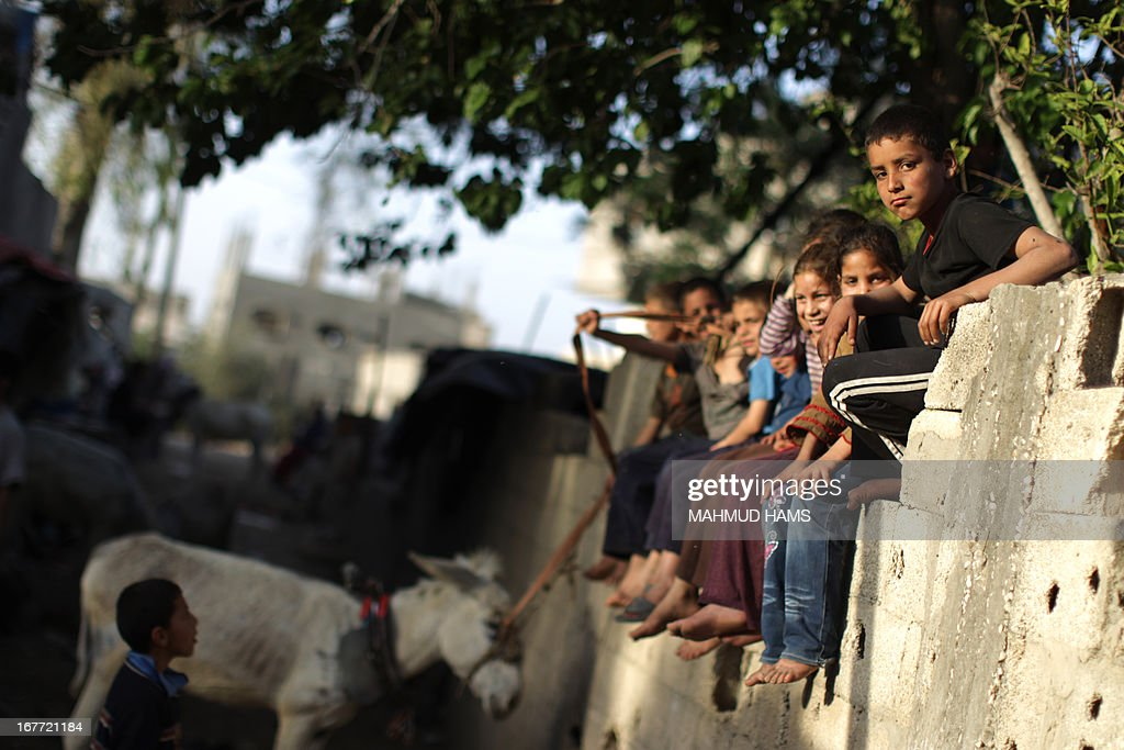 Palestinian refugee children play in a poverty-stricken quarter of the town of Beit Lahia, in the northern Gaza Strip on April 28.2013.
