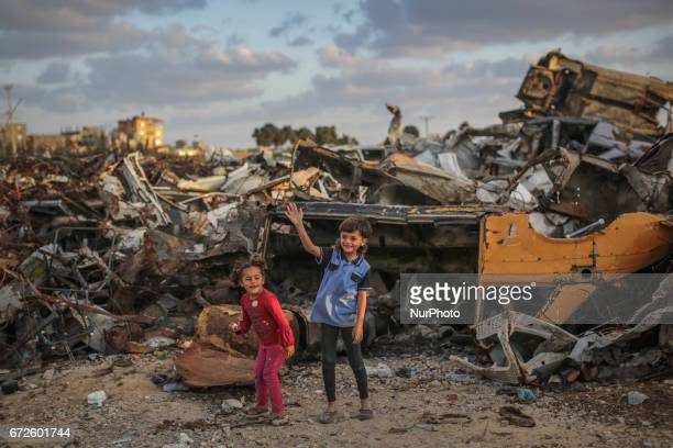 Palestinian refugee children play next their families' houses at Khanyounis refugee camp in the southern Gaza Strip 23 April 2017 With high rates of...