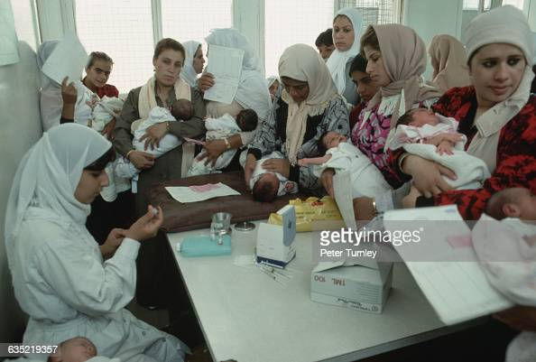 Palestinian refugee women bring their children in for medical care in Beach Camp refugee camp