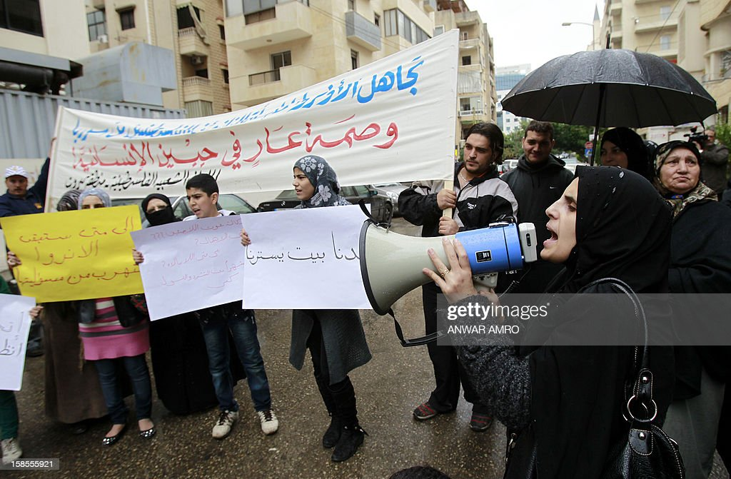 Palestinian refugees from the Syrian refugee camp of Yarmuk gather in front of the United Nations Relief and Works Agency (UNRWA) offices in the Cola district of the Lebanese capital, Beirut, on December 19, 2012. More than 2,000 Palestinians from the Yarmuk camp, on the southern outskirts of Damascus, have fled battles pitting rebels against pro-regime fighters for neighbouring Lebanon. AFP PHOTO / ANWAR AMRO