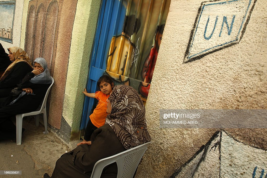 Palestinian refugees hold a sit-in outside the offices of the United Nations Relief and Works Agency (UNRWA) in Gaza city on April 8, 2013 to demand resumption of food deliveries to refugees, stopped last week after dozens of Gazans stormed a UN depot, demanding reinstatement of a monthly cash allowance to poor families which was halted from April 1 due to budget cuts. Gaza's Hamas rulers urged the UN on April 5 to reconsider its suspension of food aid for Palestinian refugees.