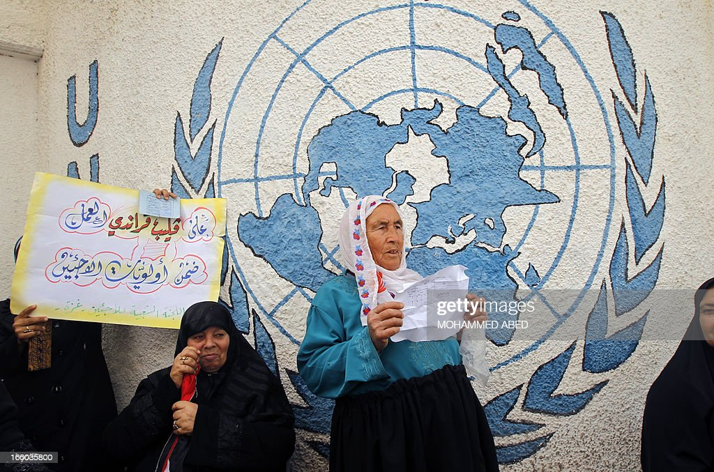 Palestinian refugees protest outside the offices of the United Nations Relief and Works Agency (UNRWA) in Gaza city on April 8, 2013 to demand resumption of food deliveries to refugees, stopped last week after dozens of Gazans stormed a UN depot, demanding reinstatement of a monthly cash allowance to poor families which was halted from April 1 due to budget cuts. Gaza's Hamas rulers urged the UN on April 5 to reconsider its suspension of food aid for Palestinian refugees.
