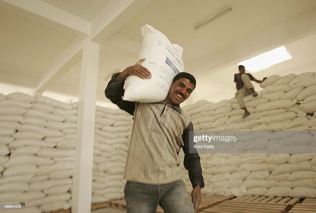 Palestinian refugees receive food aid from the European Union distributed by the World Food Program on February 28 2006 in Gaza City Gaza Strip The...