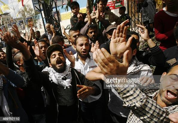 Palestinian refugees who fled the violence in Syria's Yarmuk refugee camp take part in a demonstration on April 10 2015 in the refugee camp of Ain...