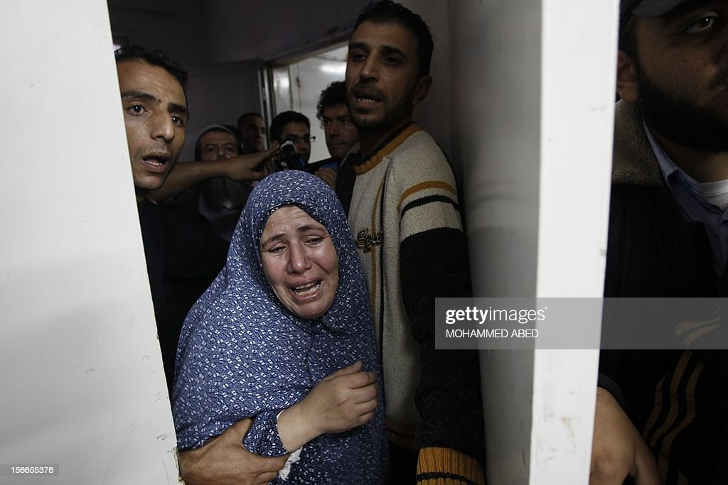 A Palestinian relative grieves at the hospital in Gaza City on November 18, 2012, after seven members of the same family, including four children, were among nine people killed when an Israeli missile struck a family home in Gaza City, the health ministry said.