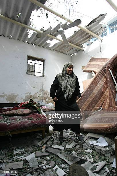 Palestinian relative of fivemonth old Mohammad Naser AlBuri inspects the damage at his family's home on February 28 2008 in Gaza City Gaza AlBuri who...