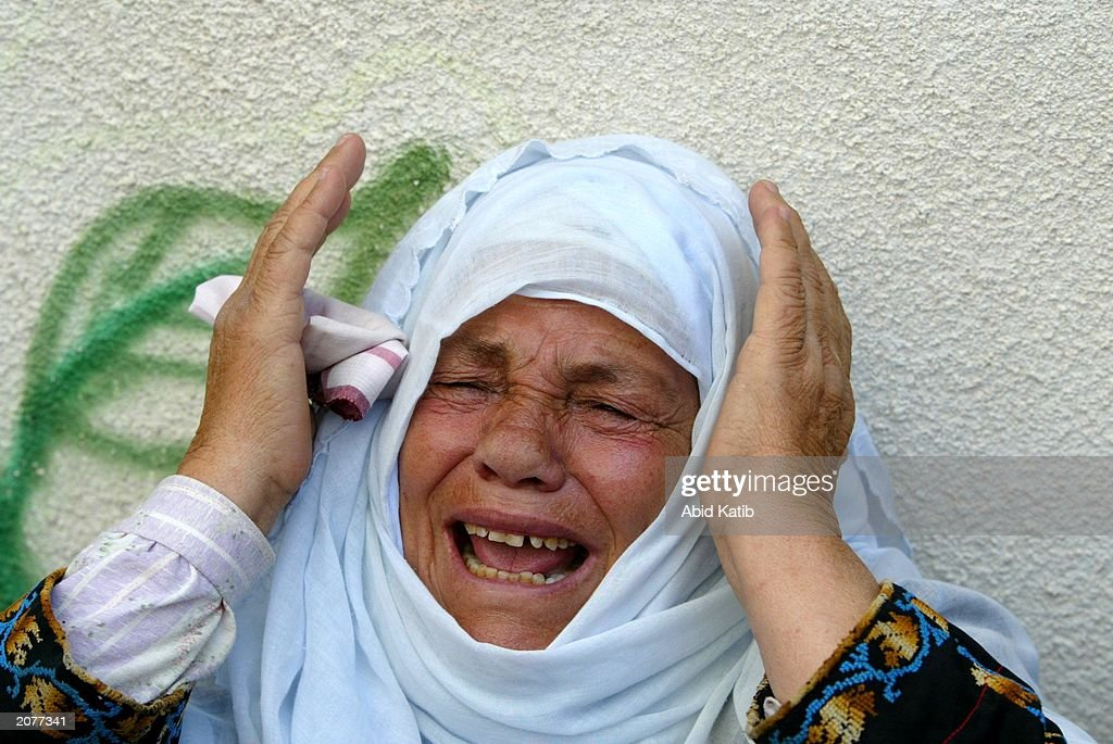 Palestinian relative of Hamas militant Tito Massoud, killed by Israeli helicopter missiles June 11, 2003, mourns during his funeral at the Jabalyea refugee camp June 12, 2003 in southern Gaza. Israeli helicopter missiles killed a total of 11 people in Wednesday's attacks. Four of the dead were Palestinian militants and seven were civilians in attacks.