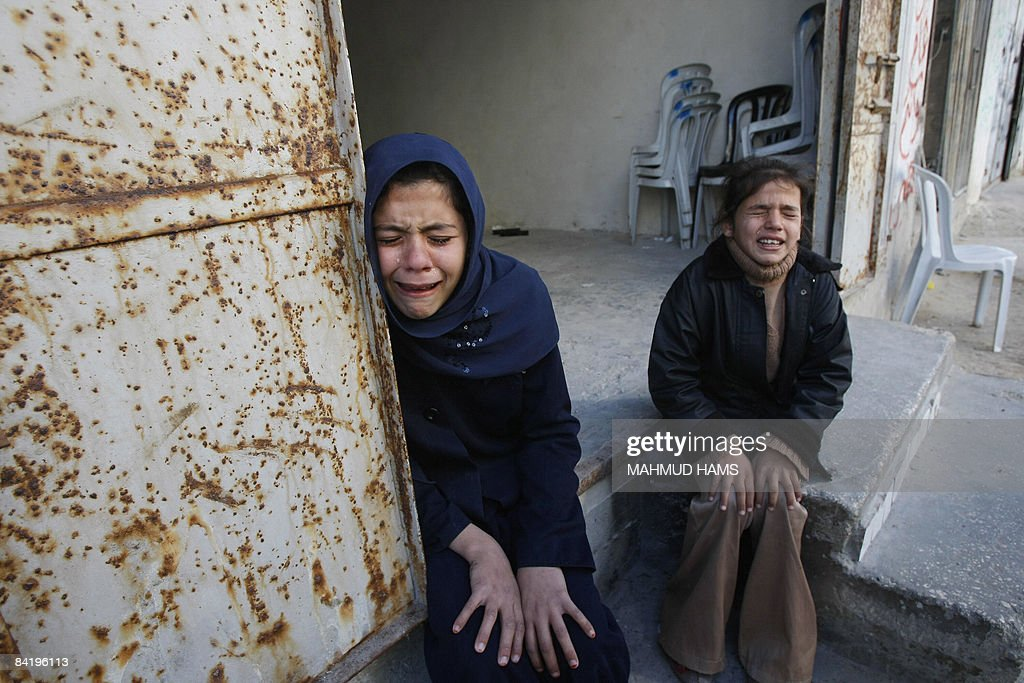 Palestinian relatives from the Deeb family cry on January 7 2009 during the funeral of 10 people from their family who were killed yesterday in an...