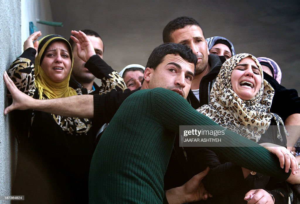 Palestinian relatives mourn during the funeral of Bashir Habaneen, 28, in the West Bank village of Mirka near Jenin on November 8, 2013 after Israeli forces shot him dead the previous night, saying he had fired a flare gun at Israelis at Tapuah Junction. Israeli border police shot dead another Palestinian at a checkpoint near Jerusalem, Israeli police and family members said, in the second fatal shooting by Israeli forces in 12 hours.