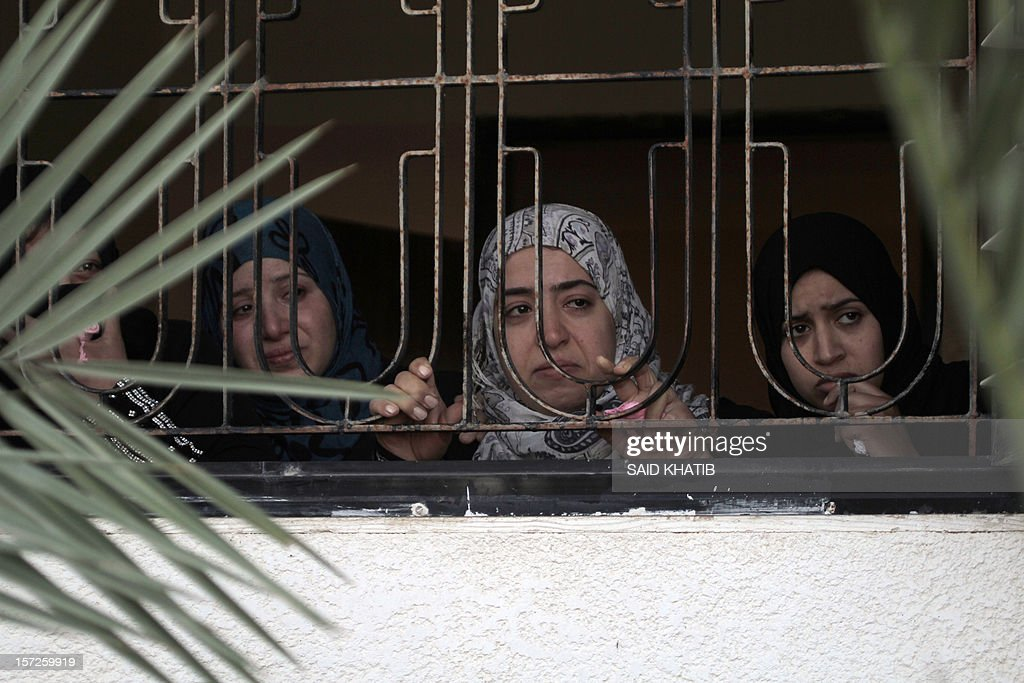 Palestinian relatives mourn over the body of Mahmoud Jarghoun, 21, during his funeral in the town of Rafah in the southern Gaza Strip on December 1, 2012. One Palestinian died and another was wounded when an Israeli missile fired days earlier exploded in the north of the Gaza Strip, an emergency services spokesman said.