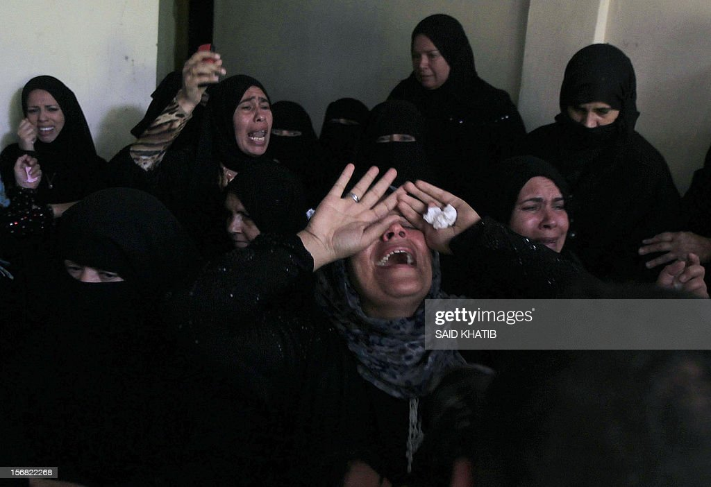 Palestinian relatives mourn the death of Amira Abu Tair, 17, during her funeral in the southern Gaza Strip town of Khan Yunis on November 22, 2012, after she was killed with her grandfather in an Israeli air strike the previous day, according to Palestinian sources. An Egypt-brokered truce took hold in the Gaza Strip, ending eight-day operation during which the Israeli army said it hit more than 1,500 targets, as Gaza militants fired 1,354 rockets over the border.