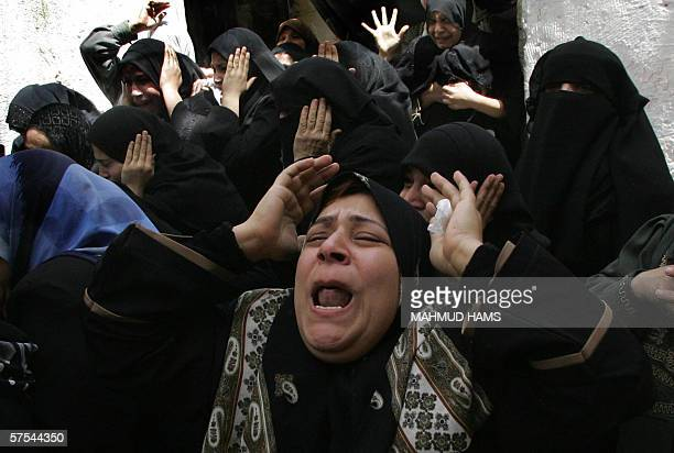 Palestinian relatives of Jumaa Doughmoush mourn during his funeral in Gaza City 06 May 2006 Dogmosh is one of five Palestinians who were killed...