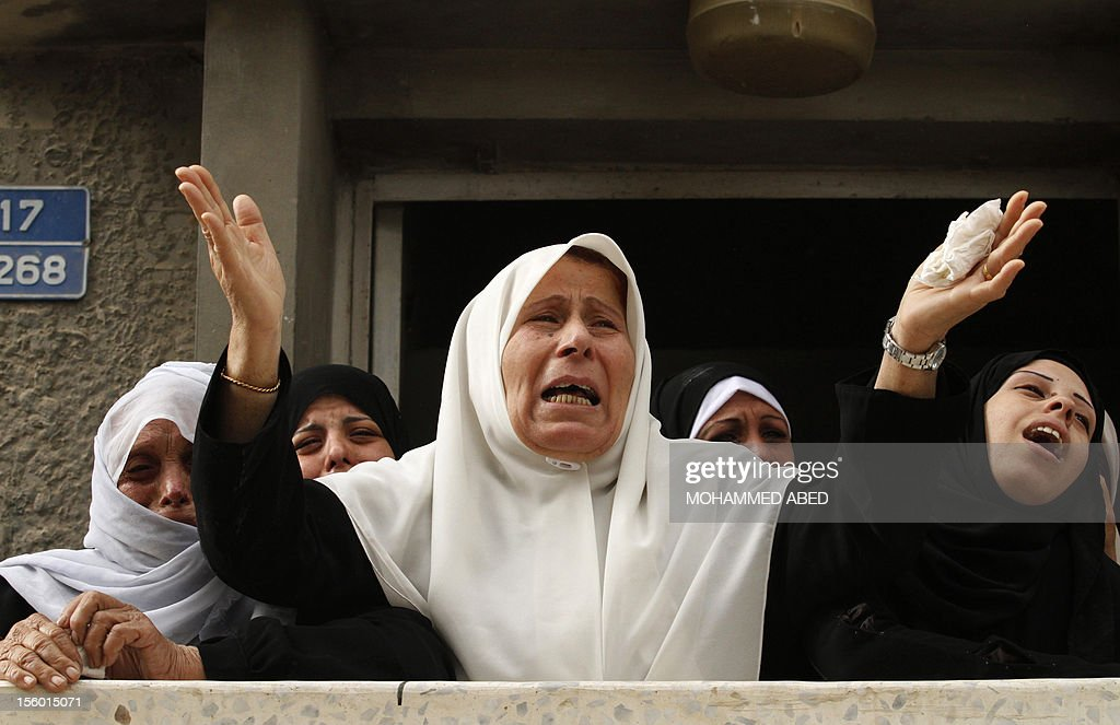 Palestinian relatives of killed civilian Ahmad Dardasawy, 18, mourn during his funeral in Gaza City on November 11, 2012, after he was killed the day before in Israeli shelling as clashes erupted along the Israeli-Gaza Strip border. The flare-up was one of the most serious since Israel's devastating 22-day operation in the Gaza Strip over New Year 2009.