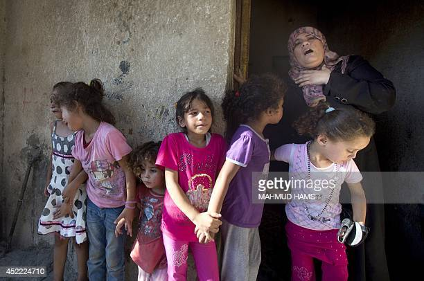 Palestinian relatives of the four boys killed in Israeli bombardment all from the Bakr family react at the family house during the funerals in Gaza...