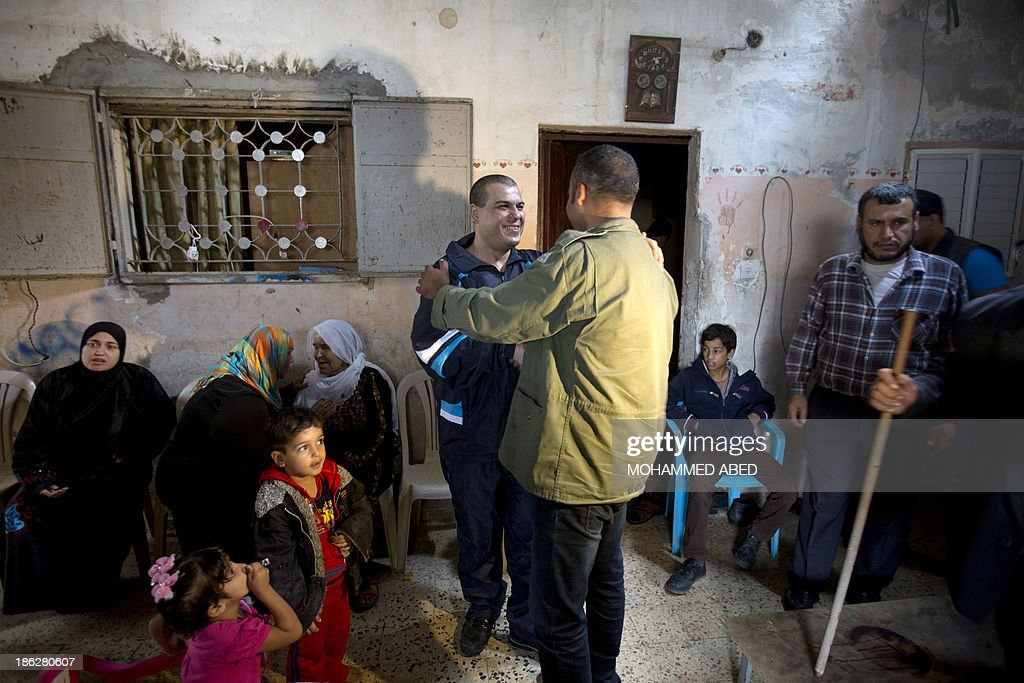 Palestinian released prisoner Omar Massud, cheers friends at his family house in al-Shatee refugee camp in Caza City on October 30, 2013. Israel freed 26 veteran Palestinian prisoners overnight in line with commitments to the US-backed peace process, but moved in tandem to ramp up settlement in annexed east Jerusalem.