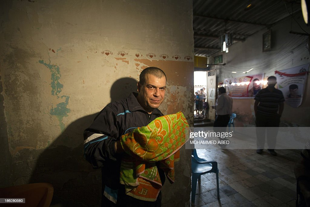 Palestinian released prisoner Omar Massud, cleans his face at his family house in al-Shatee refugee camp in Caza City on October 30, 2013. Israel freed 26 veteran Palestinian prisoners overnight in line with commitments to the US-backed peace process, but moved in tandem to ramp up settlement in annexed east Jerusalem.