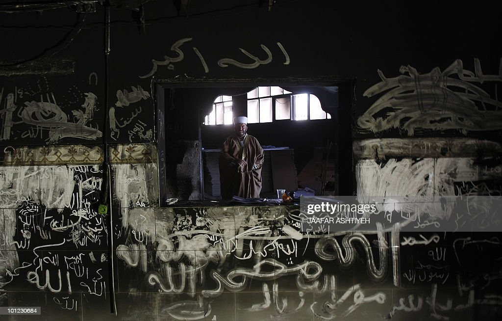 A Palestinian religious man stands inside a mosque that was burnt a few days before in the West Bank village of Lubban Ash-Sharqiya, south of Nablus, on May 07, 2010. Investigations have shown that arson was the most likely cause of a fire at a mosque in the northern West Bank, Israeli firefighters who probed the incident said.