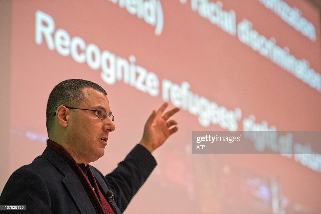 Palestinian researcher, commentator, and human rights activist Omar Barghouti speaks during a conferenceat the ULB university in Brussels, on April 30, 2013.