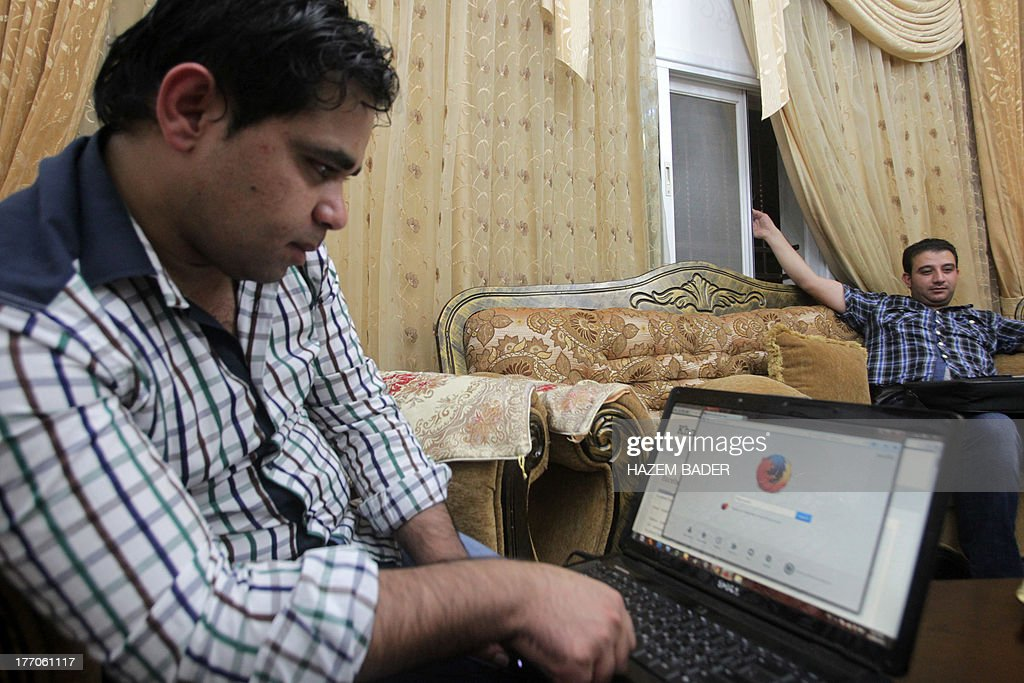 Palestinian researcher Khalil Shreateh, who hacked the day before into Facebook chief Mark Zuckerberg's profile, launches a search engine on internet on his laptop on August 20, 2013 at his home in Yatta, south of the West Bank city of Hebron. Shreateh said on his blog he found a way for Facebook users to circumvent security and modify a user's timeline.
