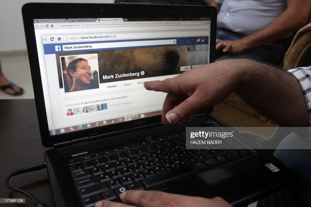 Palestinian researcher Khalil Shreateh, who hacked the day before into Facebook chief Mark Zuckerberg's profile, shows Zuckerberg's Facebook page on his laptop on August 20, 2013 at his home in Yatta, south of the West Bank city of Hebron. Shreateh said on his blog he found a way for Facebook users to circumvent security and modify a user's timeline.