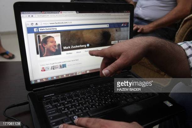 Palestinian researcher Khalil Shreateh who hacked the day before into Facebook chief Mark Zuckerberg's profile shows Zuckerberg's Facebook page on...