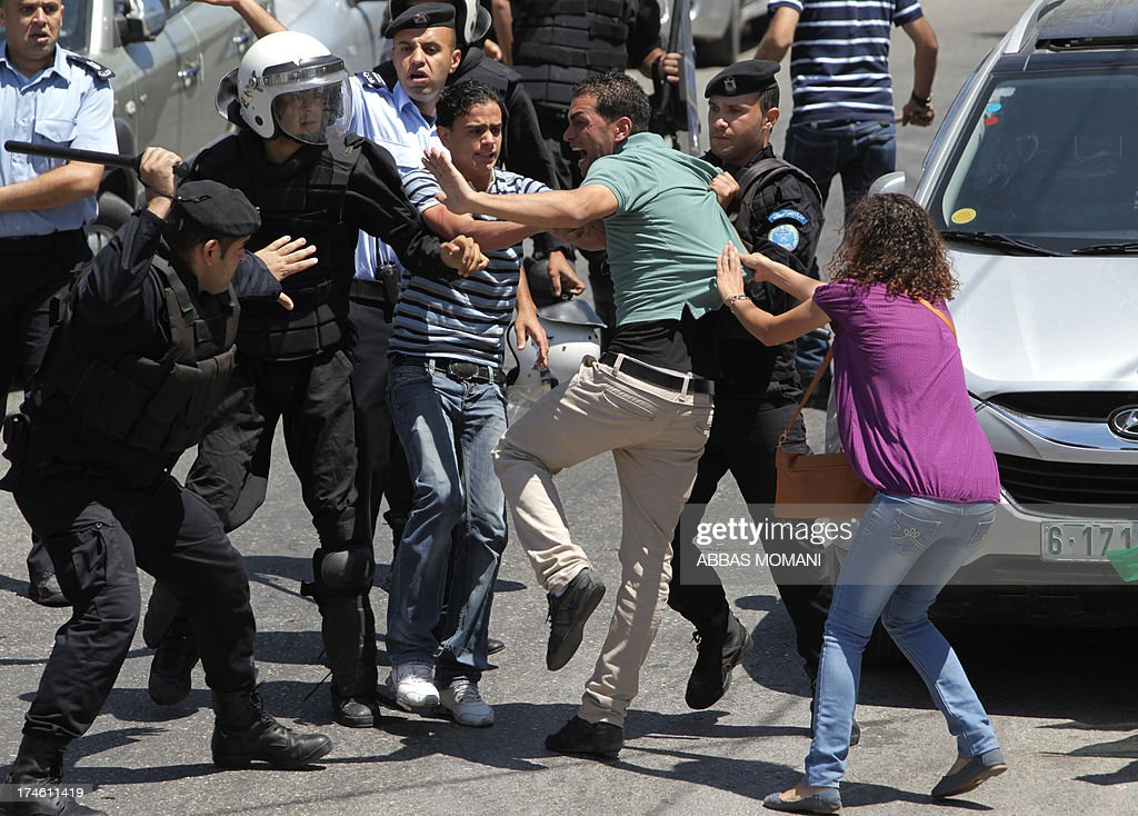 Palestinian riot police clash with protesters demonstrating against the upcoming negotiations between Palestinian leaders and Israel, as they try to march towards the headquarters of Palestinian president Mahmud Abbas, in the West Bank city of Ramallah on July 28, 2013. A Palestinian official told AFP that the US-brokered renewal of peace talks, stalled since September 2010, would open in Washington this coming week.