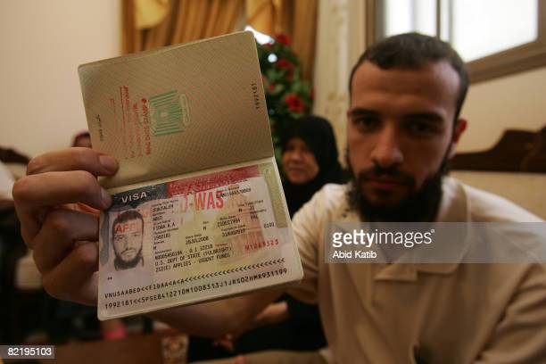 Palestinian scholar Fidaa Abed displays his Palestinian passport with cancelled stamp on the visa from the United States as he sits in his family...