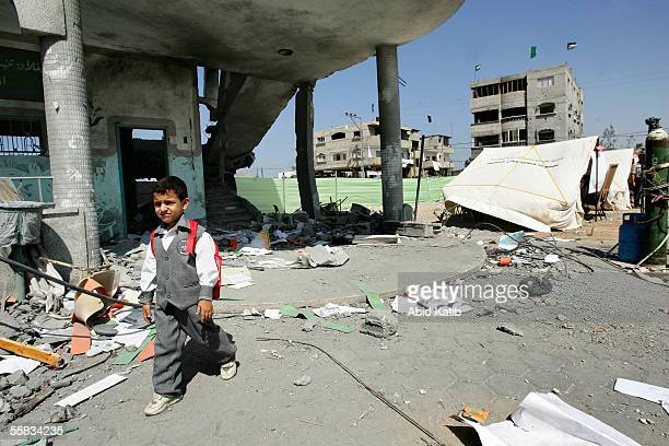Palestinian school boy walks outside his destroyed classroom at Dar AlArqam elementary school October 1 2005 in Gaza City Gaza Strip Dar AlArqam...