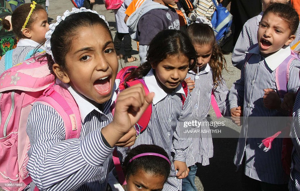 Palestinian school girls demonstrate as they ask their United Nations Relief and Works Agency for Palestine Refugees teachers to end their strike and...