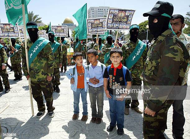 Palestinian schoolboys line up with Hamas militants during an antiIsrael rally on April 17 in Gaza Gaza Strip Thousands of palestinians attended...