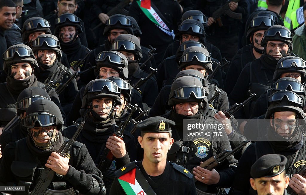 Palestinian security forces parade along the streets of the West Bank city of Nablus on January 3, 2013, during a ceremony to celebrate the 48th anniversary of the founding of the Fatah movement in Gaza. The anniversary commemorates the first operation against Israel claimed by its armed wing then known as Al-Assifa (The Thunderstorm in Arabic) on January 1, 1965. AFP PHOTO / JAAFAR AHTIYEH